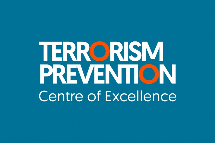 Na granatowym tle napis: Terrorism Prevention Centre of Excellence